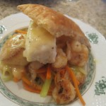 Scallops, Shrimp and Halibut with Julienne Root Vegetables and Lemon Buerre Blanc on a Pastry Puff Tile