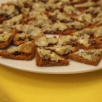 Spanish Blue Cheese with Raisins, Apple and Walnut on Crostinis