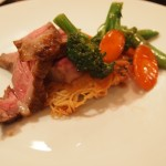 Mandarin Steak on a Pan Fried Noodle Cake with Stir Fried Vegetables